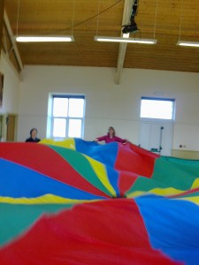 Twenty babies and toddlers are hiding under the parachute.